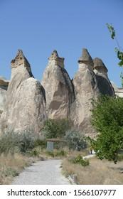 Fairy chimney balanced rock formations and troglodyte cave houses,  Pasabaglari, Cappadocia, Turkey
