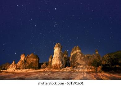 Fairy chimneys at night with stars in the sky, Cappadocia, Turkey