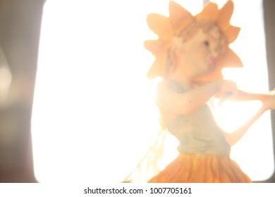 Fairy dolls made of resin Playing music with leaves and wood is an instrument. with soft blur.