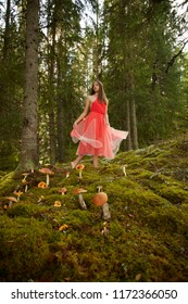 Fairy forest girl in a calm peaceful place,  Dalarna county, Sweden. Mushrooms, moss and red dress. Calm, solitude and soul.