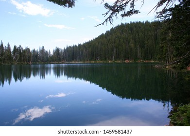 Fairy Lake in the Bridger Mountains of Montana reflecting the sky and trees