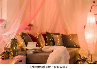Fairy lights and baldachin in teen bedroom