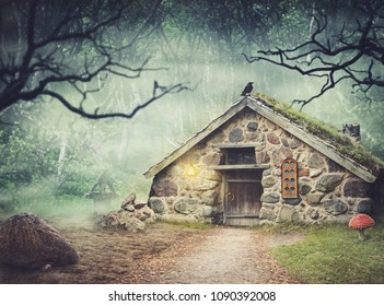 Fairy old stone house in fantasy dark forest with fog