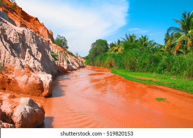 Fairy Stream Canyon, Mui Ne, Vietnam, Southeast Asia. Beautiful scenic landscape with red river, sand dunes and jungle. Tropical oasis scenery. Popular, famous landmark, tourist destination of Vietnam