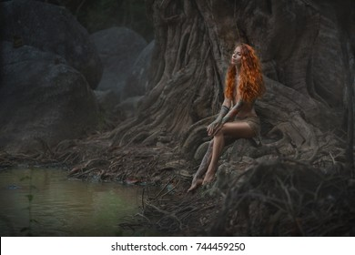 Fairy tale. Mystical female person in a unusual ancient nature pensively sits near the pond