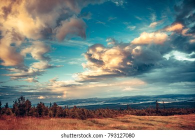 Fairy tale scenery the fantastic bright sky in white blue yellow shades. Splash of colors in the Tatras Mountains in Slovakia. Natural phenomena. Artistic retouching.