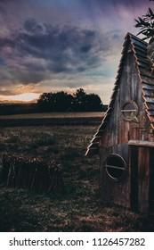 Fairy tale small wooden hut near the lavender field in  Poland
