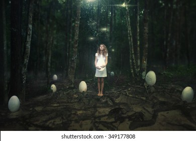 Fairy tale.Young girl in mystery garden hold big egg and  dreamily looking up
