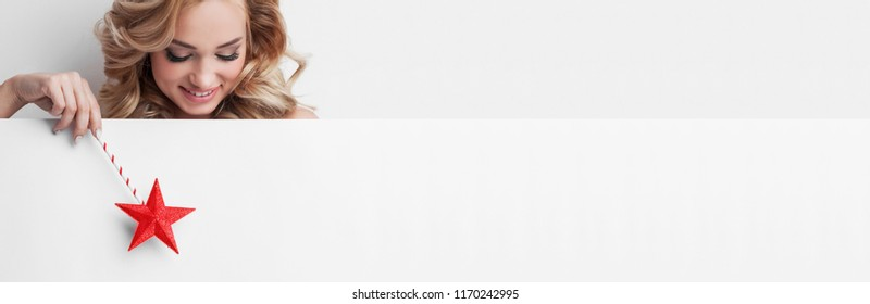 Fairy woman with magic wand with star pointing at white background with copy space for text