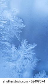 Fairy-like sparkling winter background (slightly blurred frostwork on a window glass)