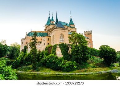 Fairytale castle Bojnice in Slovakia; Scenic landscape of medieval castle towering on the green hill