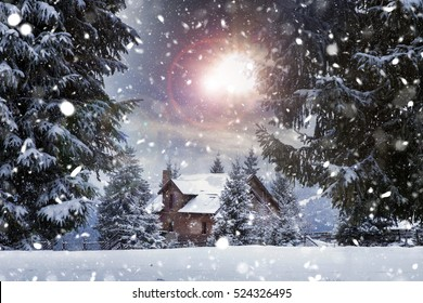 Fairy-tale cottage in woods at winter. Christmas concept.