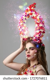 Fairytale girl with floral horns and fantastic make-up. Malifiscent. Spring or summer beauty.Goddess of flowers Flora.