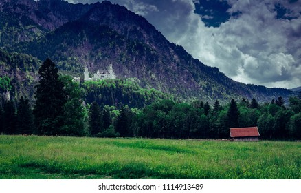 The fairytale Neuschwanstein Castle and a barn in the foreground