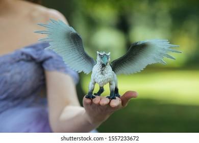 Fairytale princess holding her gryphon pet