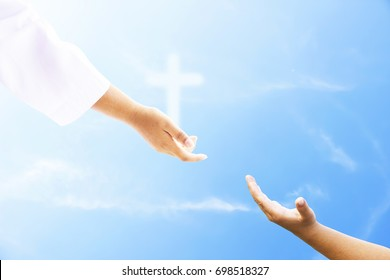Faith concept: Human reaching hand with palm up over blurred nature background.