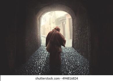 Faithful friar walking praying