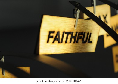 FAITHFUL on a wooden sign, photograph Aspirations word