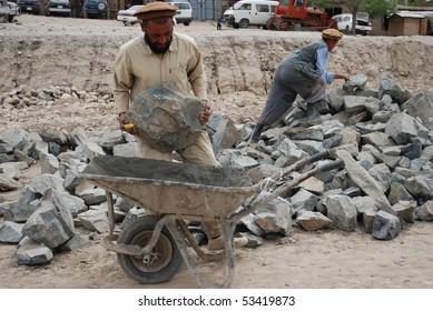 FAIZABAD - APRIL 25: Afghan stonemasons from Faizabad, Badakhshan, work on new road April 25, 2009 between Keshim and Faizabad, northern Afghanistan.