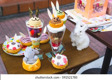Fake desert models known as 'samples' or 'sampuru' with a rabbit theme outside a cafe to entice customers inside.