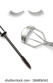 Fake false eyelash with eyelash curler and mascara Isolated on white background