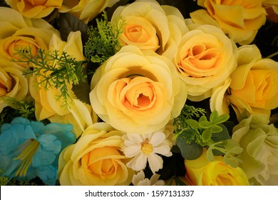 Fake flower and Floral background. rose flowers made of fabric. The fabric flowers bouquet. Colorful of decoration artificial flower