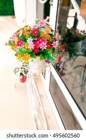 Fake flower on cute bicycle for building interior decoration