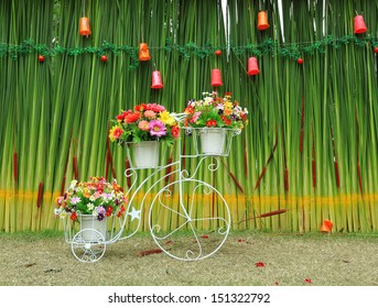 Fake flowers in the vase on a bicycle