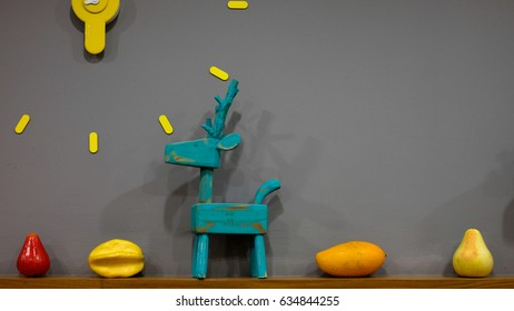Fake fruit toy and wooden block of dear