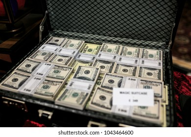 Fake group of dollar banknotes suitcase