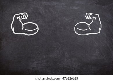 fake muscles drawn on the blackboard, body type written with chalk, no people