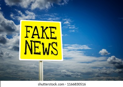 Fake news road sign with cloudy sky background. Propaganda and disinformation concept.