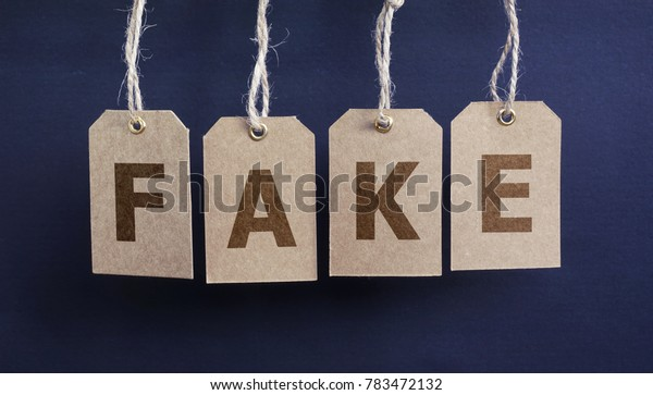 Fake news sign concept with letters on hanged paper tags.