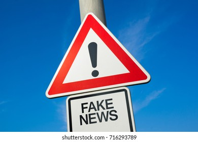 Fake News  - traffic sign with exclamation mark to alert, warn caution - precaution and warning of false information, hoax, disinformation, misleading misinformation, propaganda and manipulation