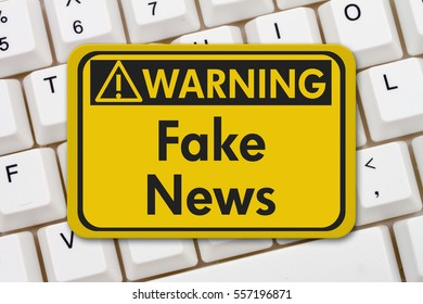 Fake news warning sign, A yellow warning sign with text Fake News on a keyboard 3D Illustration