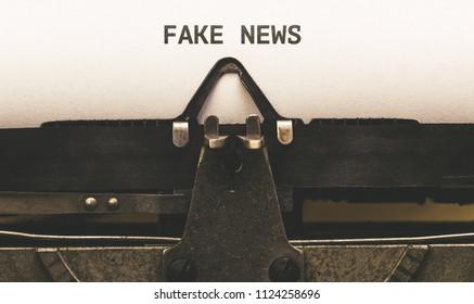 Fake News, written on paper in vintage typewriter