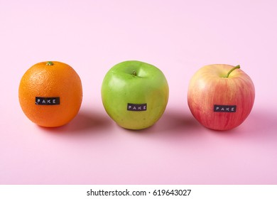 Fake plastic fruit -apples and orange   - can be used for fake concept or fake news
