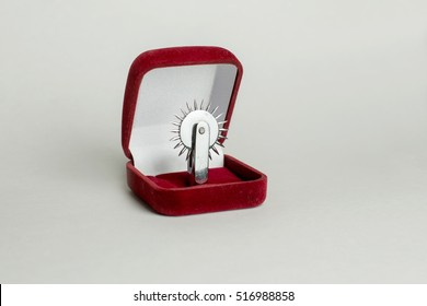 Fake proposal that instead of a wedding ring inserted Wartenberg Wheel, which is used in BDSM