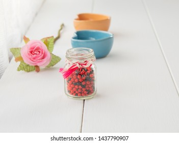 Fake roses, black and red flower seeds and a heart-shaped window display