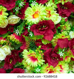 fake roses and chrysanthemums, floral background