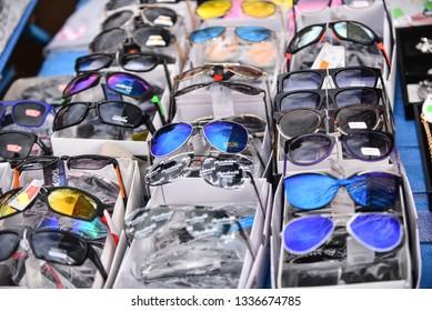Fake sunglasses being sold at the Patpong night market. Bangkok, Thailand - March, 2017