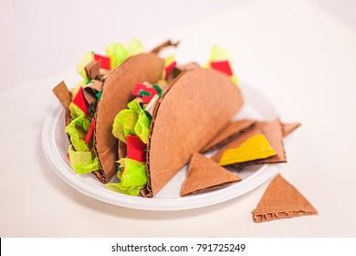 Fake tacos made of cardboard, fast food, junk food.