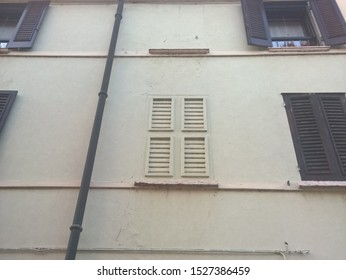 Fake window with fake wooden shutters, depicted in bas-relief on the wall.
