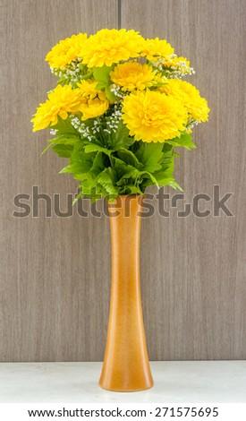 Fake yellow flower vase table marble stock photo edit now fake yellow flower in vase at table marble on wooden background mightylinksfo