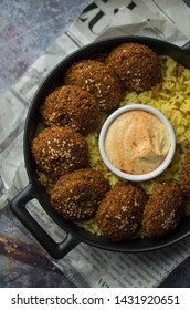 Falafel balls with rice and hummus