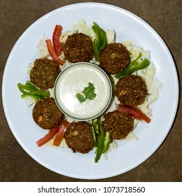 Falafel balls (tikki) with Tahini sauce -  Middle Eastern food - lebanese cuisine from top view