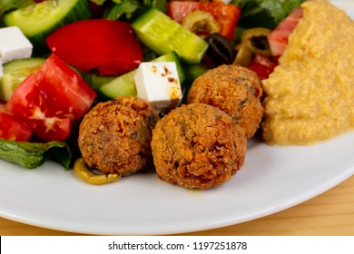 Falafel with humus ower the wooden background