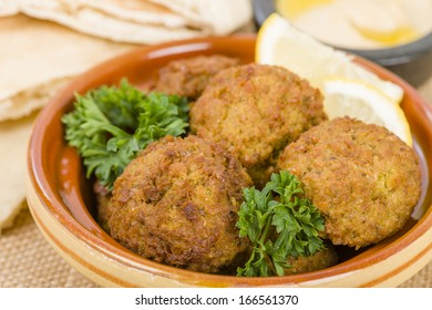 Falafel -  Middle Eastern chickpea and fava beans fried balls. Traditional spicy snack.