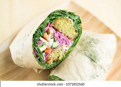 Falafel mustard green wrap