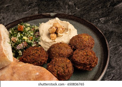 falafel on plate with hommos and tabouli salad